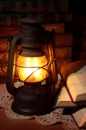 kerosene lamp: Old oil lamp and old books