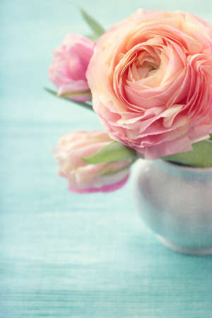 shabby chic background: Pink flowers in a vase