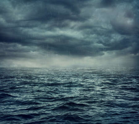 storm clouds: Rain over the stormy sea, abstract dark background