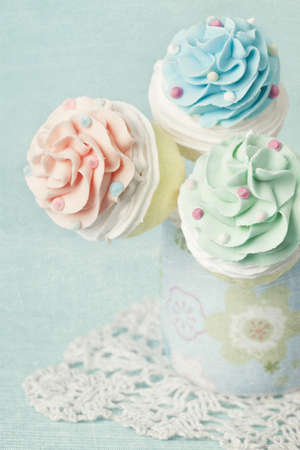 Colorful cupcake pops on blue photo