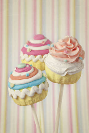 Colorful cupcake pops on striped background Stock Photo - 13561337