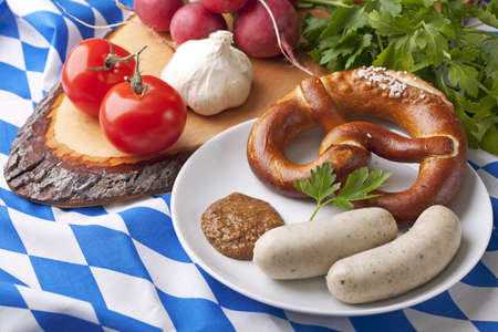 veal sausage:  Bavarian white sausages with  sweet mustard and bretzels