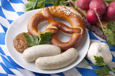 sweet mustard: Bavarian white sausages with  sweet mustard and bretzels Stock Photo