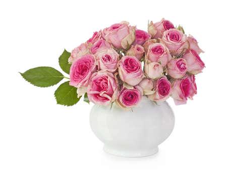 antique vase: Pink roses in a vase on white background