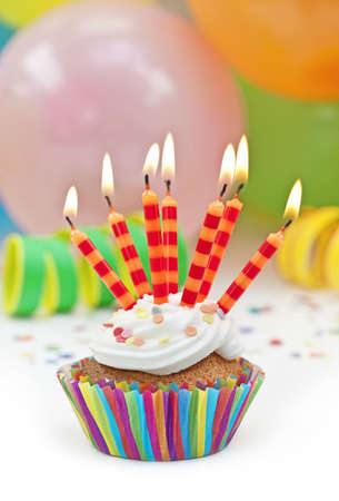 birthday cupcakes: Colorful birthday candels and balloons Stock Photo