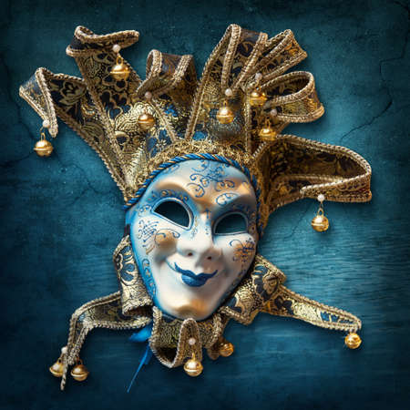 Abstract blue background with venetian mask photo
