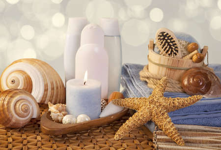 Spa elements with  towels,candle and bottles photo