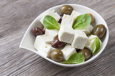 Cubed feta cheese with olives photo