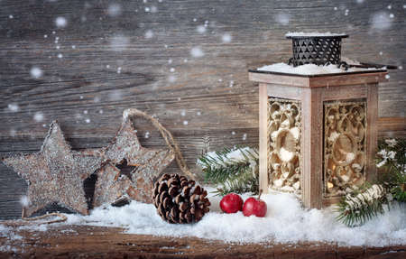 country christmas: Burning lantern in the snow