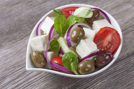 cubed: Cubed feta cheese with olives, tomatoes and onion Stock Photo
