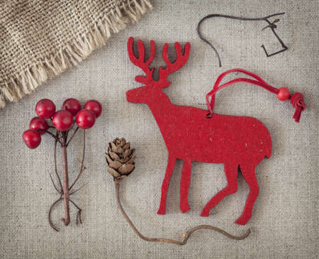 Red christmas deer on fabric background photo