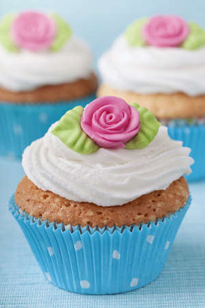 Cup cakes with pink marzipan rose photo