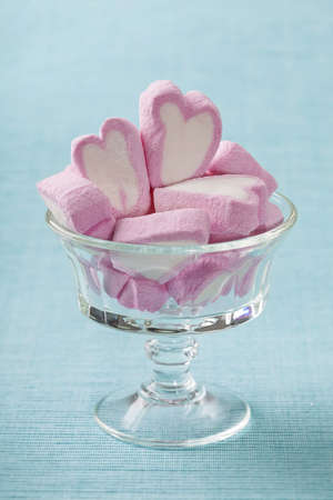 candy hearts: Marshmallow hearts in glass bowl