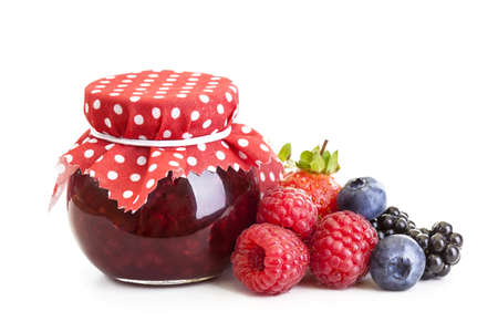 Jam and fresh berries isolated on white photo