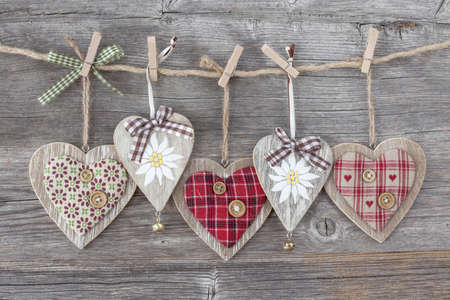 clothespin: Hearts over a wooden background