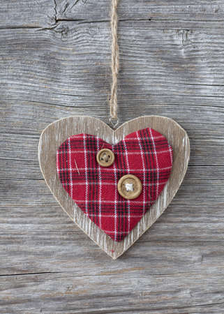 Heart over a wooden background photo