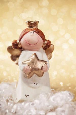 Christmas angel on golden background photo