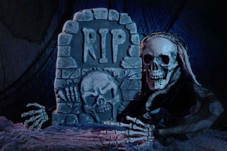 grave stones: Skull monster and tombstone halloween decoration Stock Photo