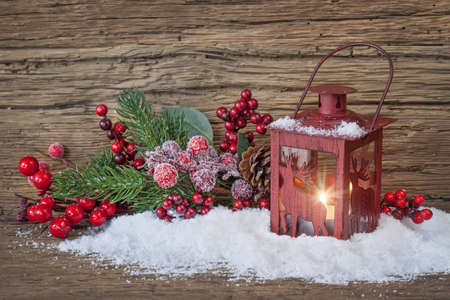 christmas candle: Burning lantern in the snow