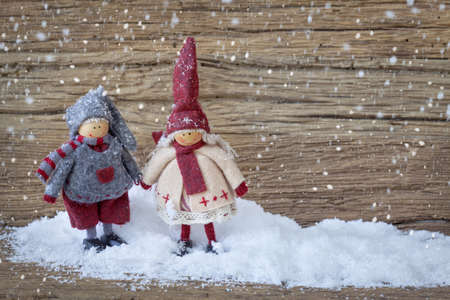 with copy space: Two little santa decoration on wooden background