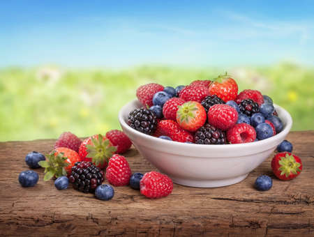 Fresh fruits on wooden desk photo