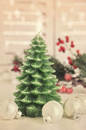 Christmas tree candle on white background photo