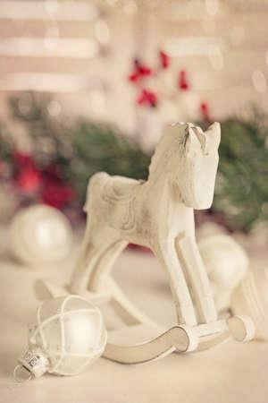 rocking horse: Wooden rocking horse on white table