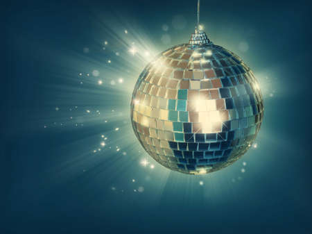 Disco ball on green background photo