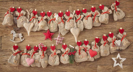 Advent calendar on wooden background Stock Photo