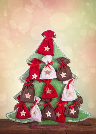 Christmas tree advent calendar on wooden desk Stock Photo - 16279088