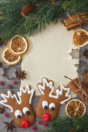 recipe decorated: Blank note and christmas cakes on wooden background