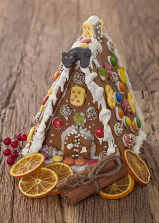 Gingerbread house on wooden background photo