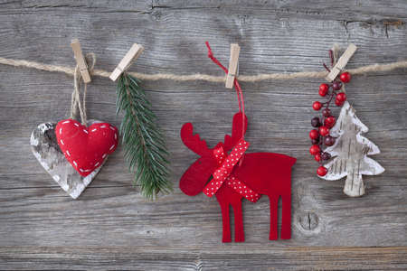Wooden christmas deer and decoration on wooden background photo