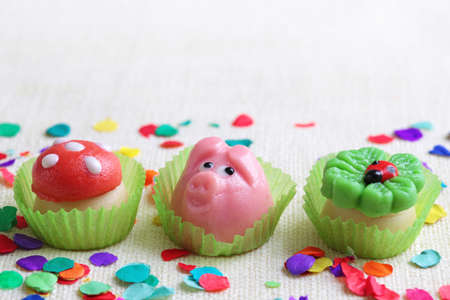 cloverleaf: Marzipan pig,mushroom and cloverleaf on white background