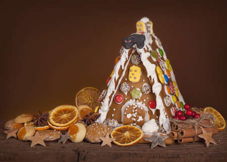Gingerbread house on brown snowy background photo
