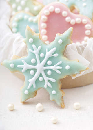 Pastel colored cookies on white background photo