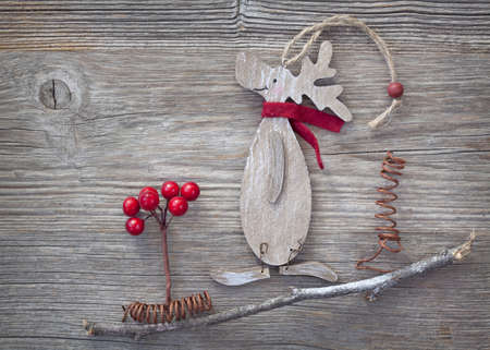 Wooden christmas deer on wooden background photo