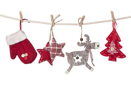 Christmas decorations hanging isolated on white background photo