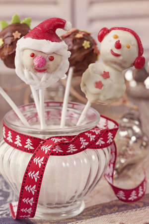 Christmas cake pops in a vase with sugar photo