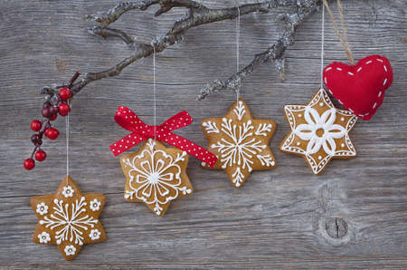 christmas gingerbread: Snowflake gingerbread cookies on wooden background Stock Photo