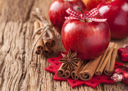 Red winter apples with cinnamon sticks and anise Stock Photo