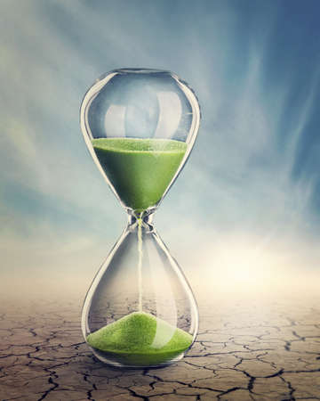 Time concept with a hourglass photo