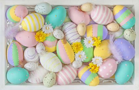 Easter pastel colored eggs close up photo