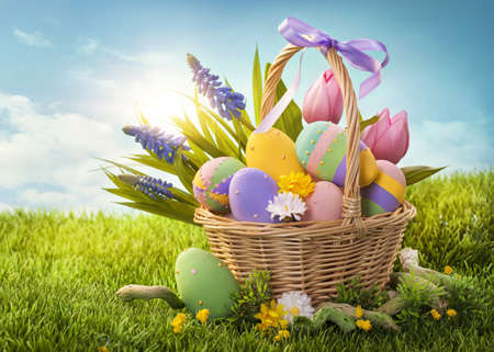 easter decorations: Basket with easter eggs  on green grass