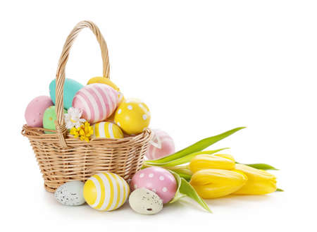 easter decorations: Basket with easter eggs on white background