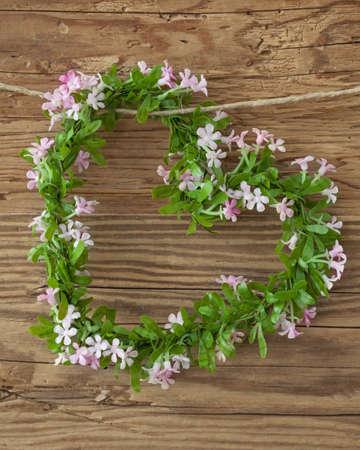 valentin: Green heart on wooden background Stock Photo