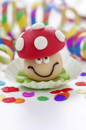 luckiness: Marzipan mushroom on white background