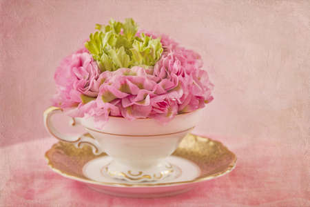 Ranunculus flower in a tea cup photo