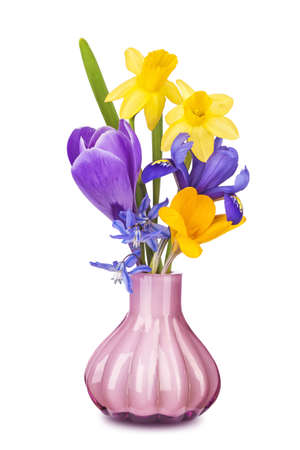 Colorful spring flowers in a vase isolated on white background photo