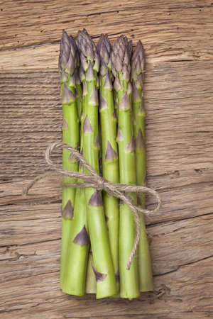 Green asparagus on a wooden background Stock Photo